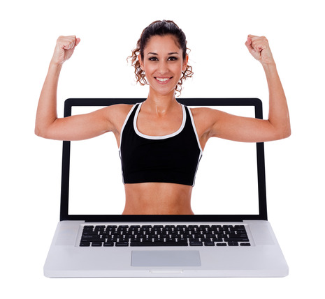 Fitness woman showing a exercises  position through laptop scree